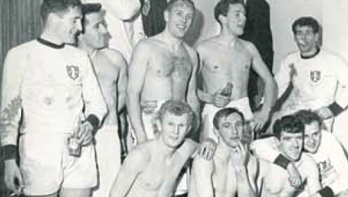Jimmy Briggs, Tommy Neilson and others were holding cigarettes