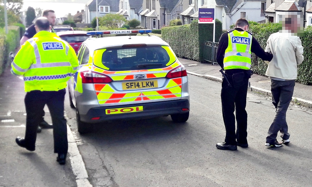 A suspected housebreaker being arrested by police in Dundee.