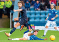 Martin Woods battles with St Johnstone's Ross Callachan