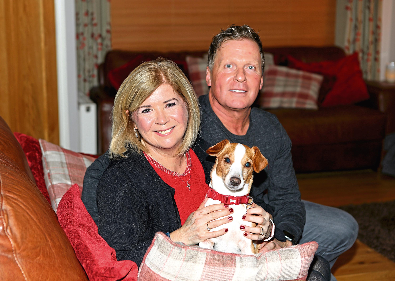 Linda and husband Matt with their dog Betsy
