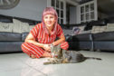 Jordan May Brown with her surviving cat Madz, who lost a leg in a similar accident on Americanmuir Road