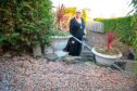 Doris says raw sewage is flooding her garden and steps to her house
