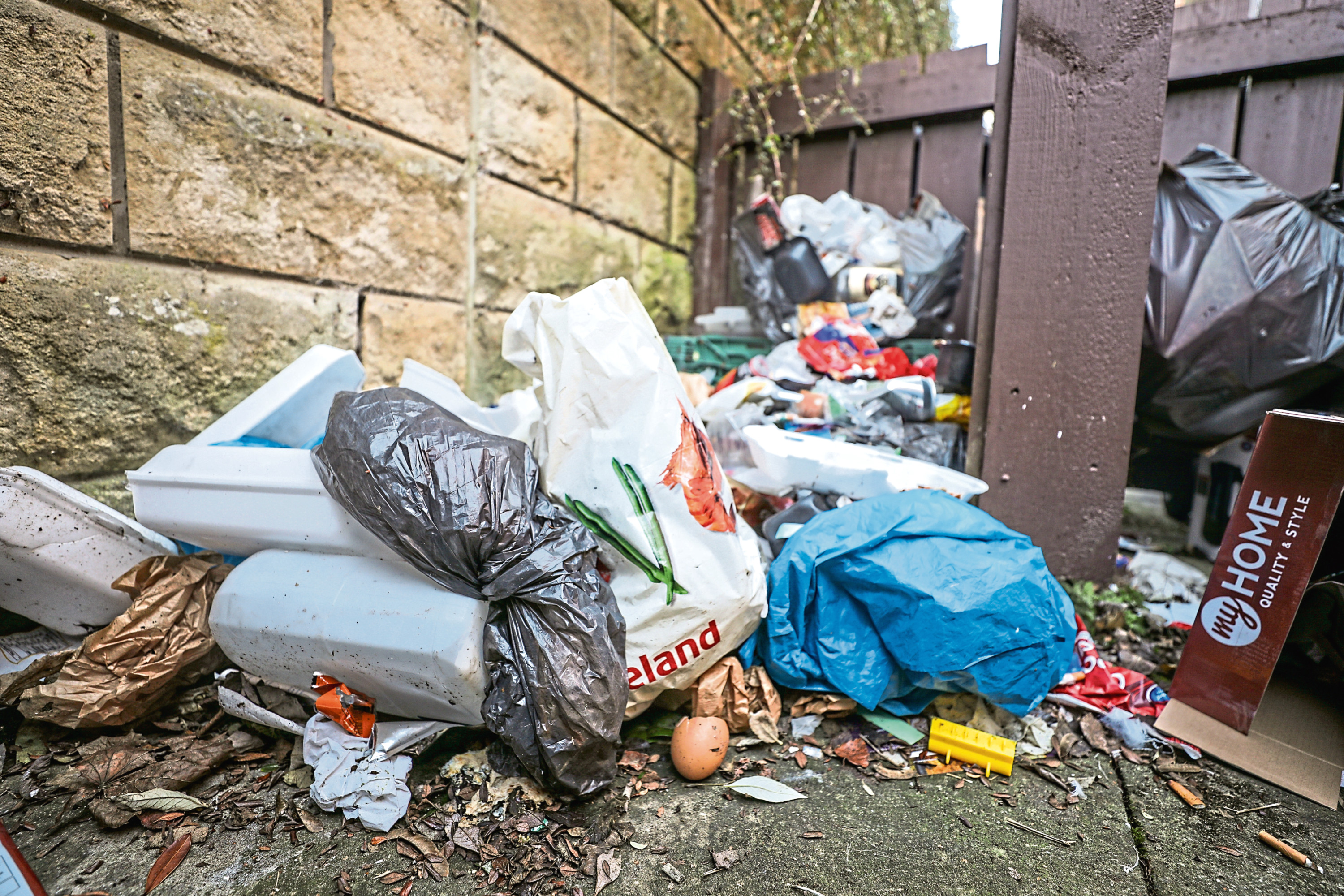 Rubbish piled up at the back of Dot Murray's home