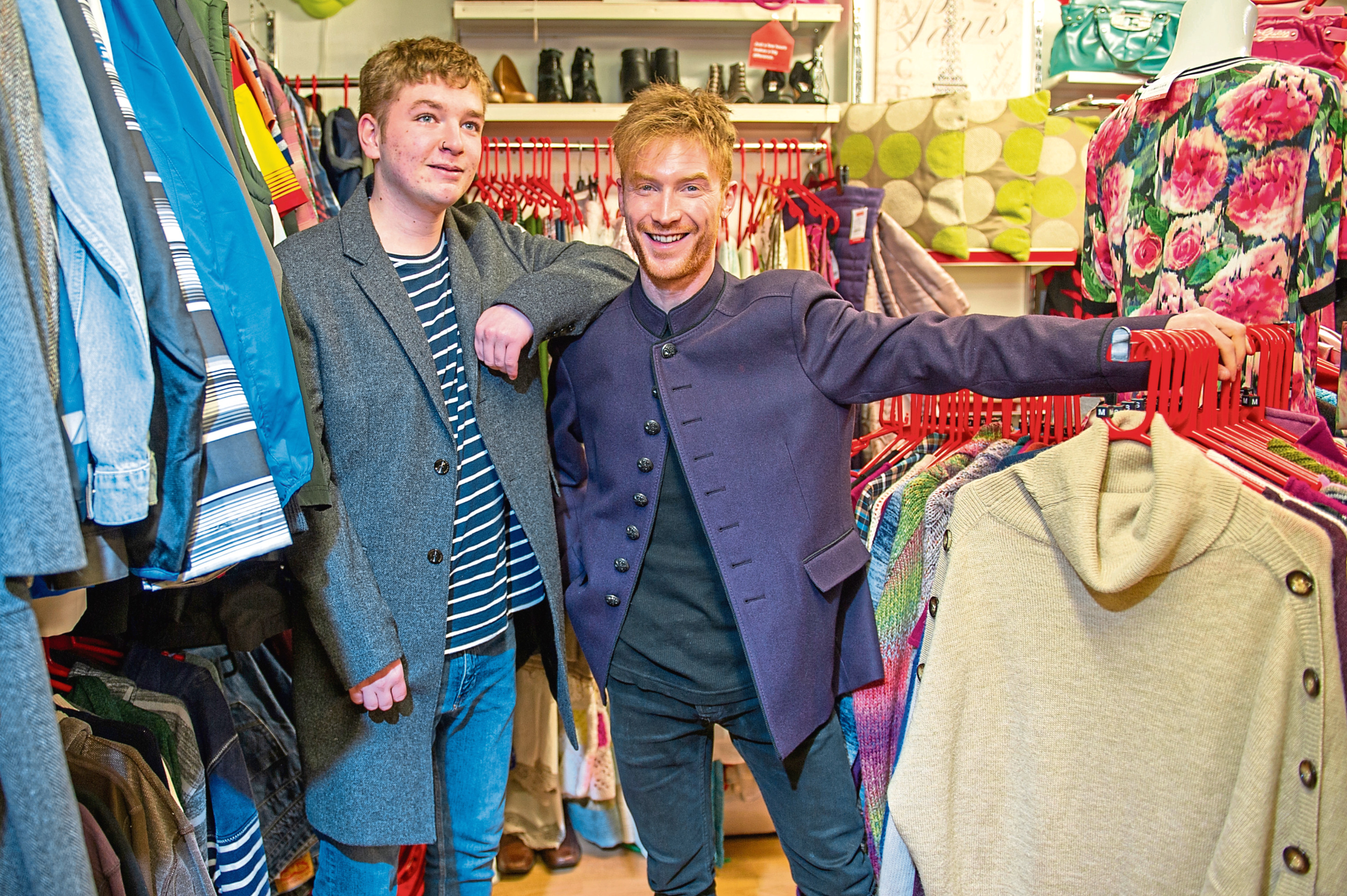 n Picture shows Matthew Tonner, left, and Adam Topen trying on some of the designer clothing.
