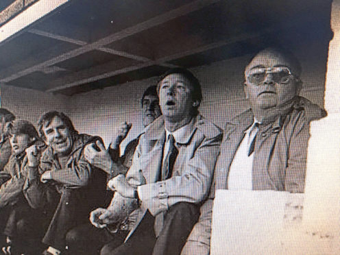 Sir Alex Ferguson's first game in charge of Man United in 1985. The person on his left is said to be the team bus driver