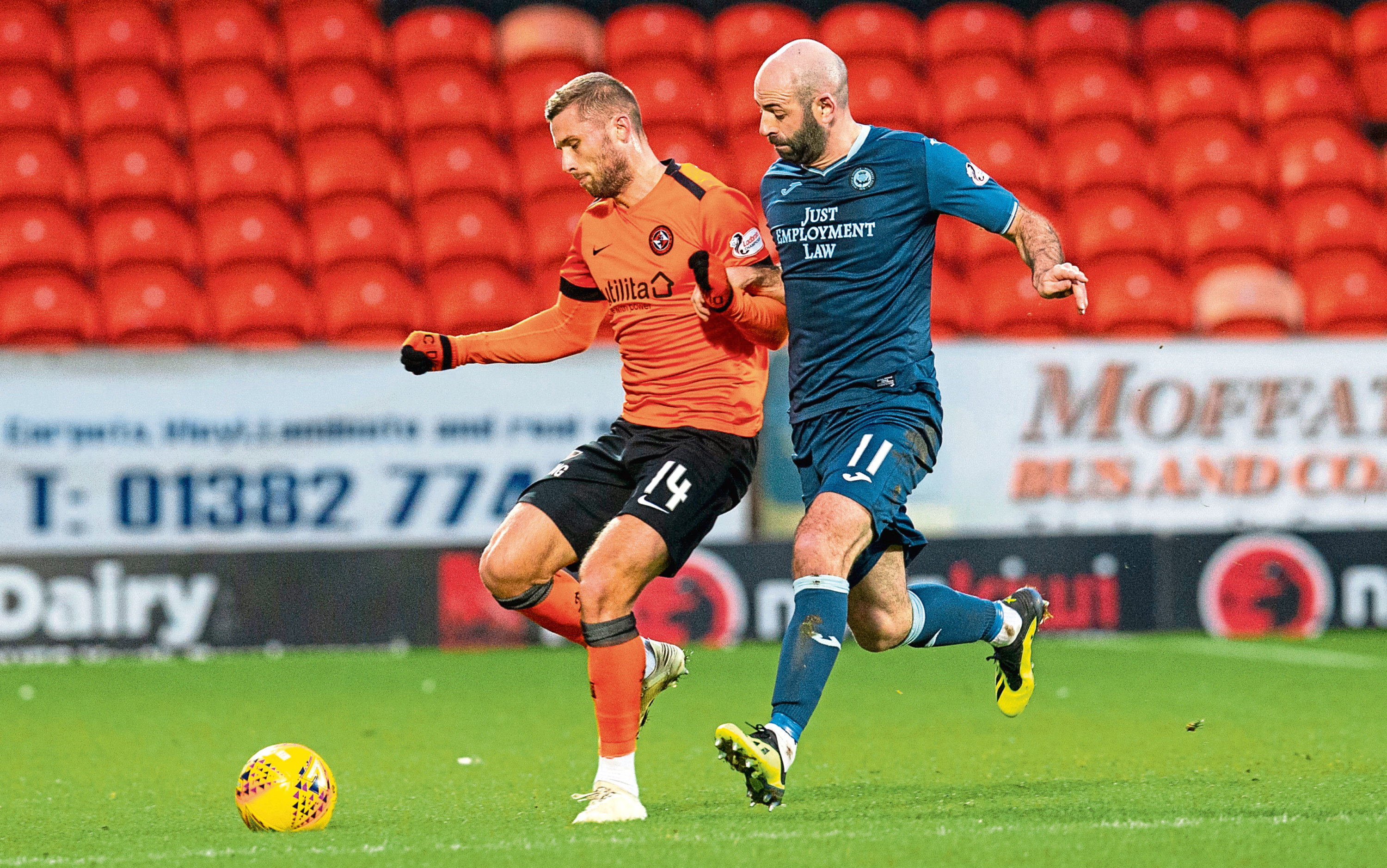 Dundee United's Pavol Safranko battles with Partick Thistle's Gary Harkins