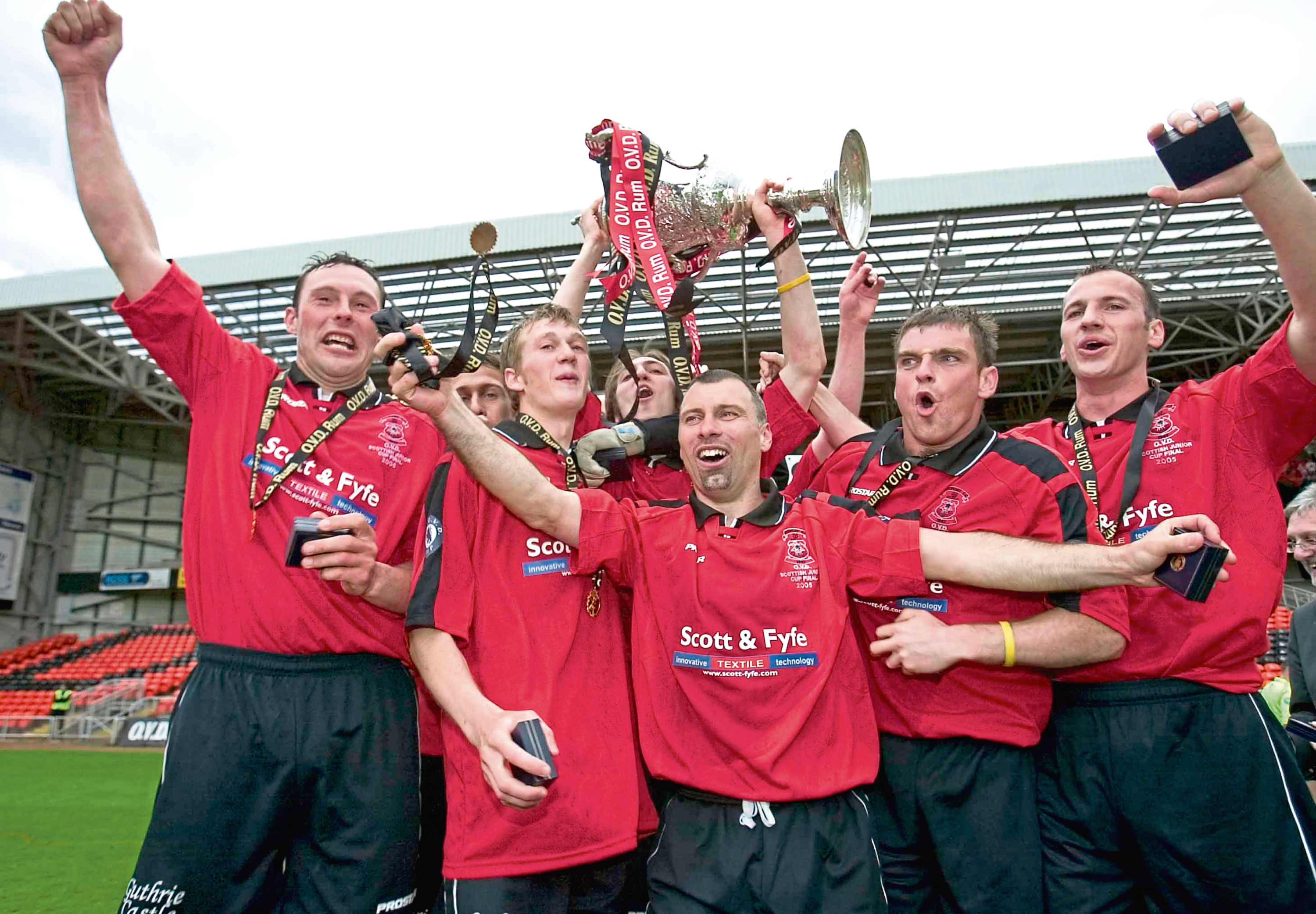Tayport players celebrating their 2005 Scottish Junior Cup Final win over Lochee United at Tannadice