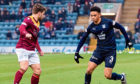 Dundee's Nathan Ralph takes on Queen of the South's Andrew Stirling on Saturday