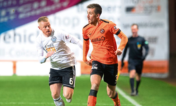 Dundee United's Callum Booth goes away from Ayr United's Andy Geggan when the visitors won 5-0 at Tannadice in November 2018