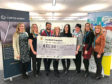 Picture shows (from left) Curtis Banks staff Jennifer Steedman, Stef Hume, Arafat Abir, Linda Meiklejohn of Archie, Gemma Herd, Aileen Paterson, Lesley Croll and Jenny Leith