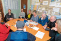 n Picture shows Shona Robison meeting with the board of the Hearing Voices Network at their Hilltown headquarters.