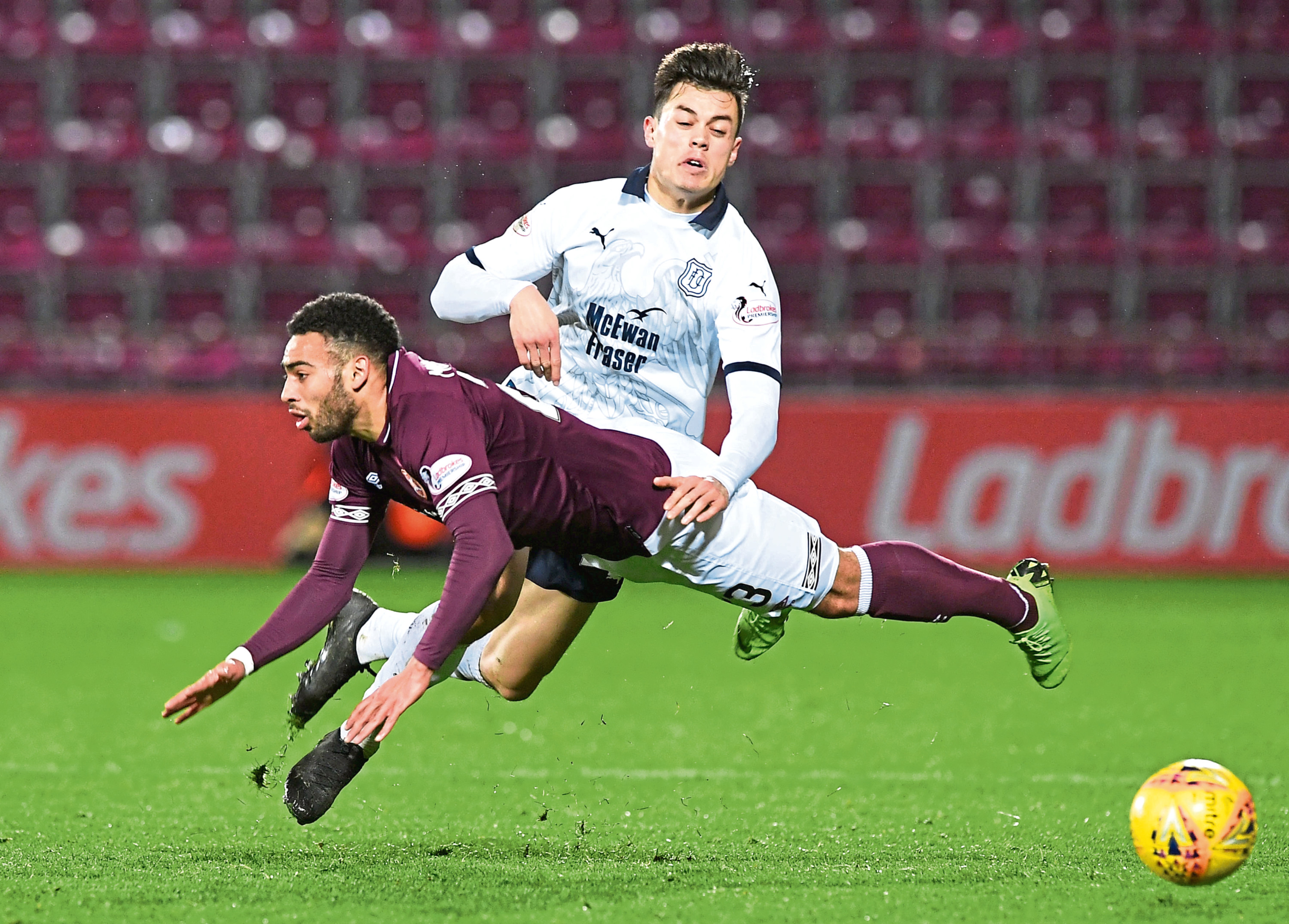 Jesse Curran flies into a tackle with Hearts' Jake Mulraney which Dundee boss Jim McIntyre feels epitomised his side's display in a 2-1 win last night