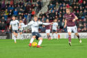 Andrew Nelson rifled home the winner in Dundee's 2-1 victory over Hearts at Tynecastle on Wednesday night to lift the Dee off the bottom of the Premiership table.