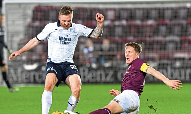 Hearts' Chritophe Berra challenges Craig Curran last season. Berra is expected to be one of McPake's main transfer targets.