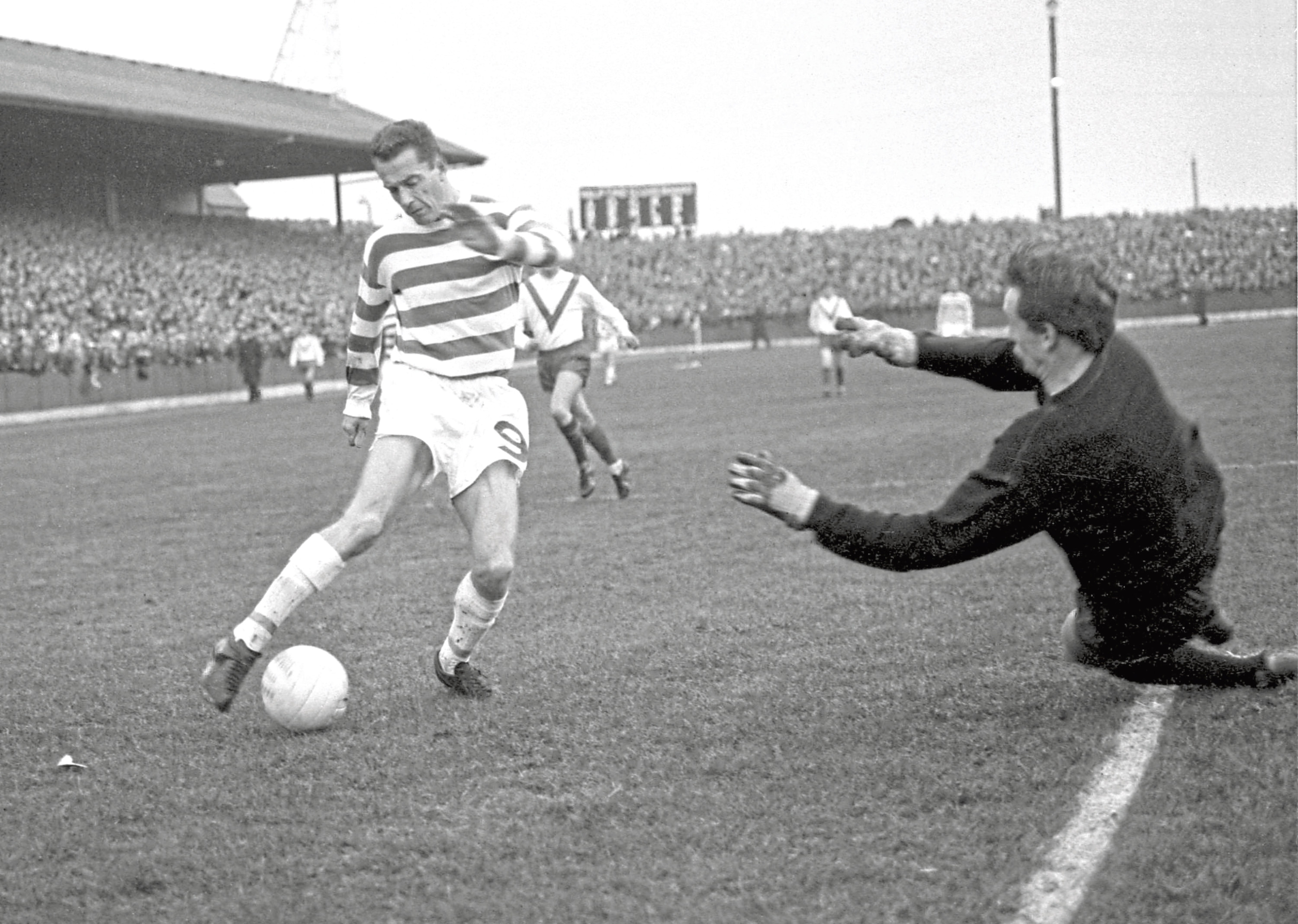 Celtic's Steve Chalmers in action against Airdrie goalkeeper Roddy McKenzie
