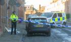 Police in Sidney Street, Arbroath following the stabbing in January.