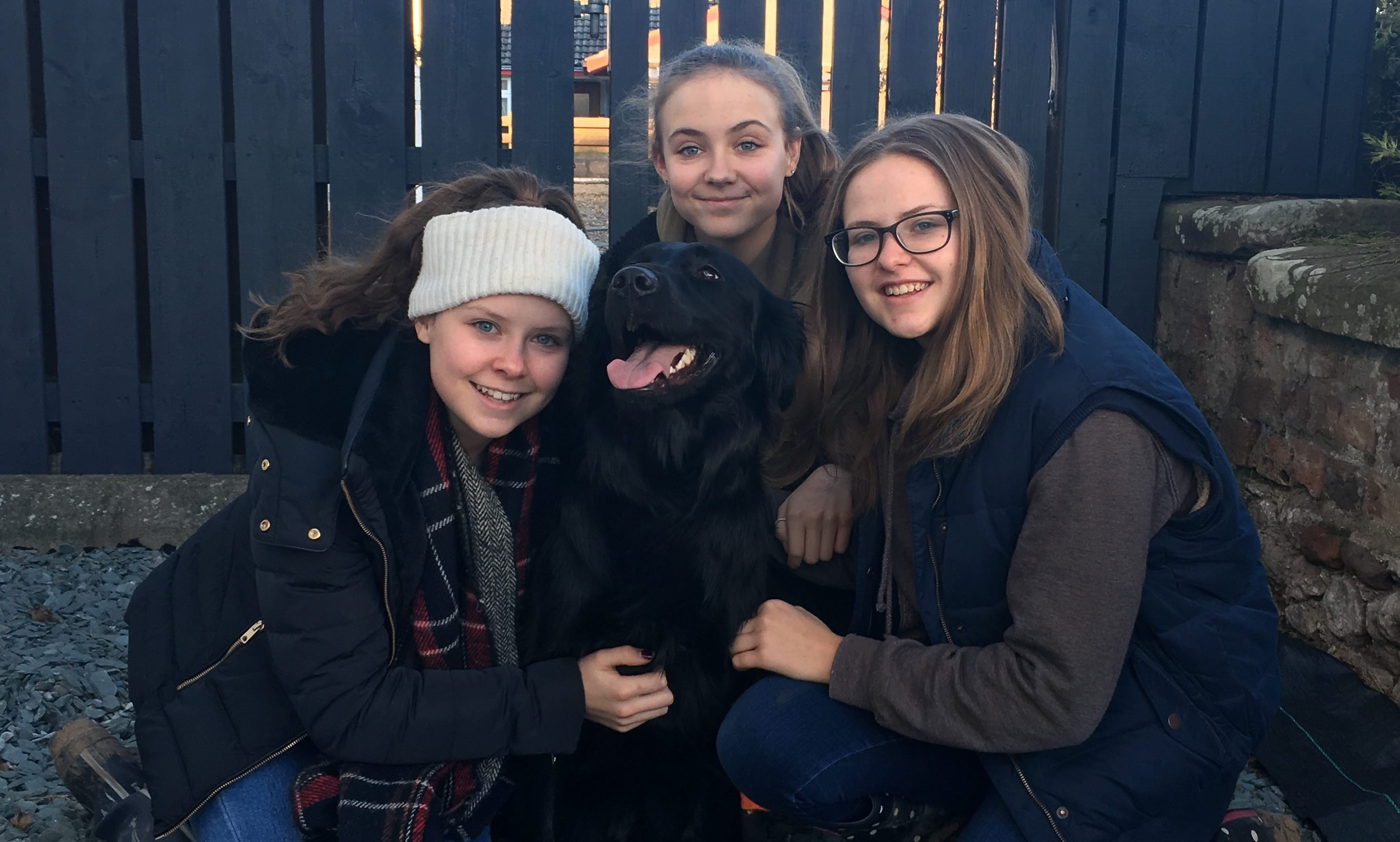 Ciara, Rowan and Eilidh Walker, who are looking after guide dog Hope