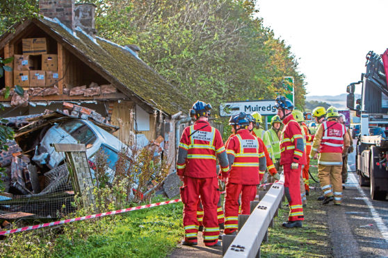 Courier News - Perth - Jamie Buchan Story. RTA / Crash on A90 dual carriageway; at least one car has collided with a property. Picture shows Ambulance, Police and Fire crews on the scene where car has hit the property; car being recovered. A90 Westbound - half mile east of Glendoick junction. Tuesday 24th October 2017.