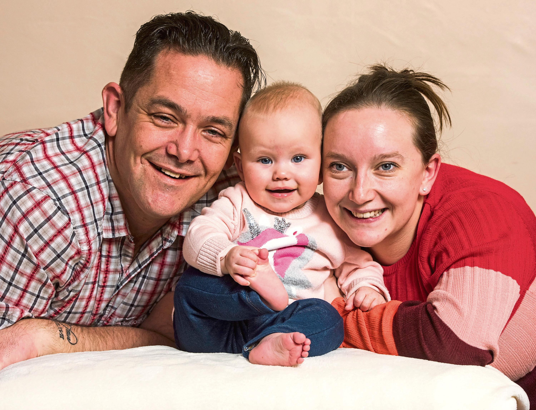 Darren Aitken and Kat with baby daughter Jessica