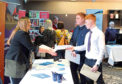 Evening telegraph news CR0005985 G Jennings pics, McGills job fayre at the Apex,. handing in Cv,s.thursday 7th february.