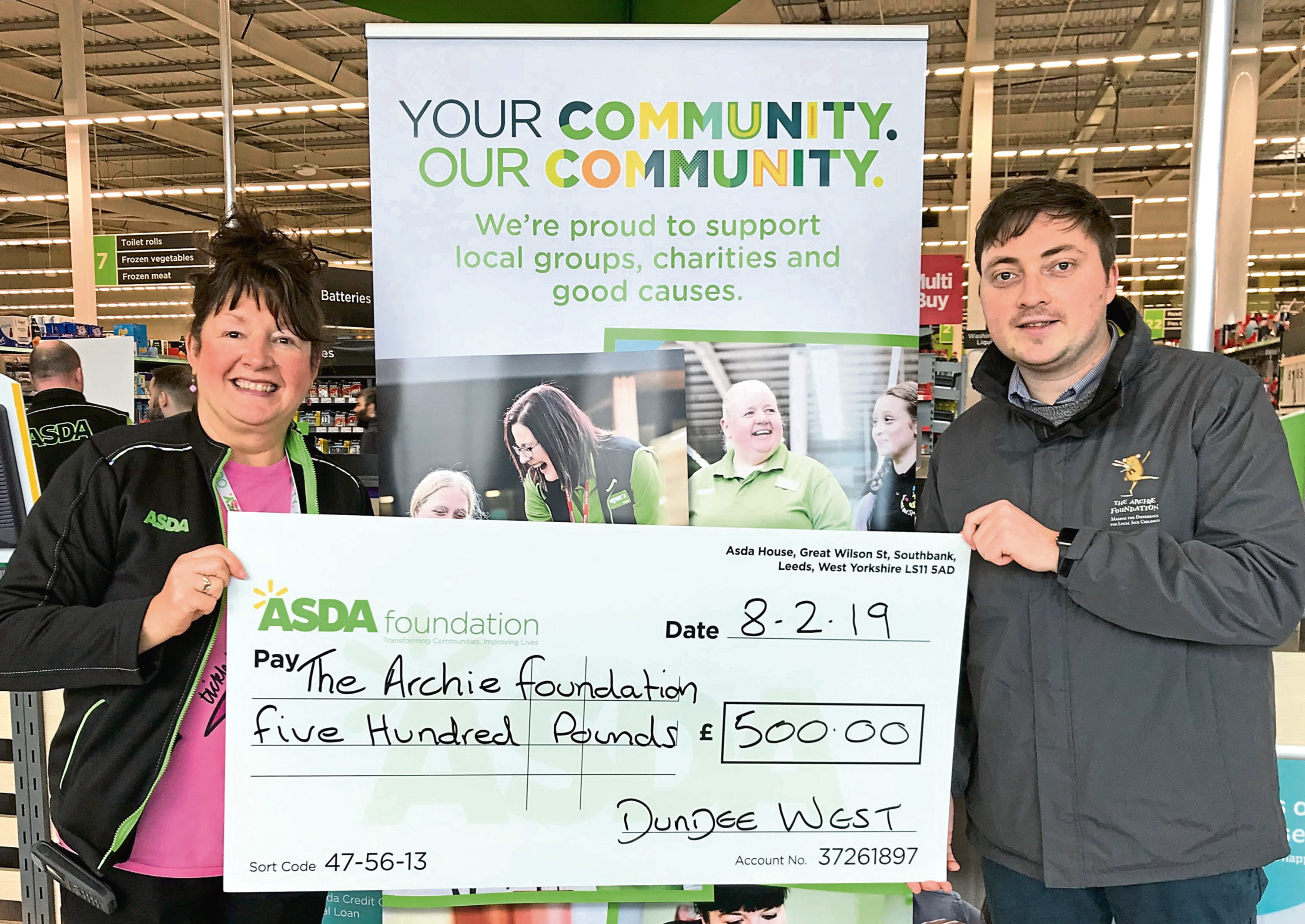 Scott Lorimer, right, receives the cheque on behalf of the Archie Foundation