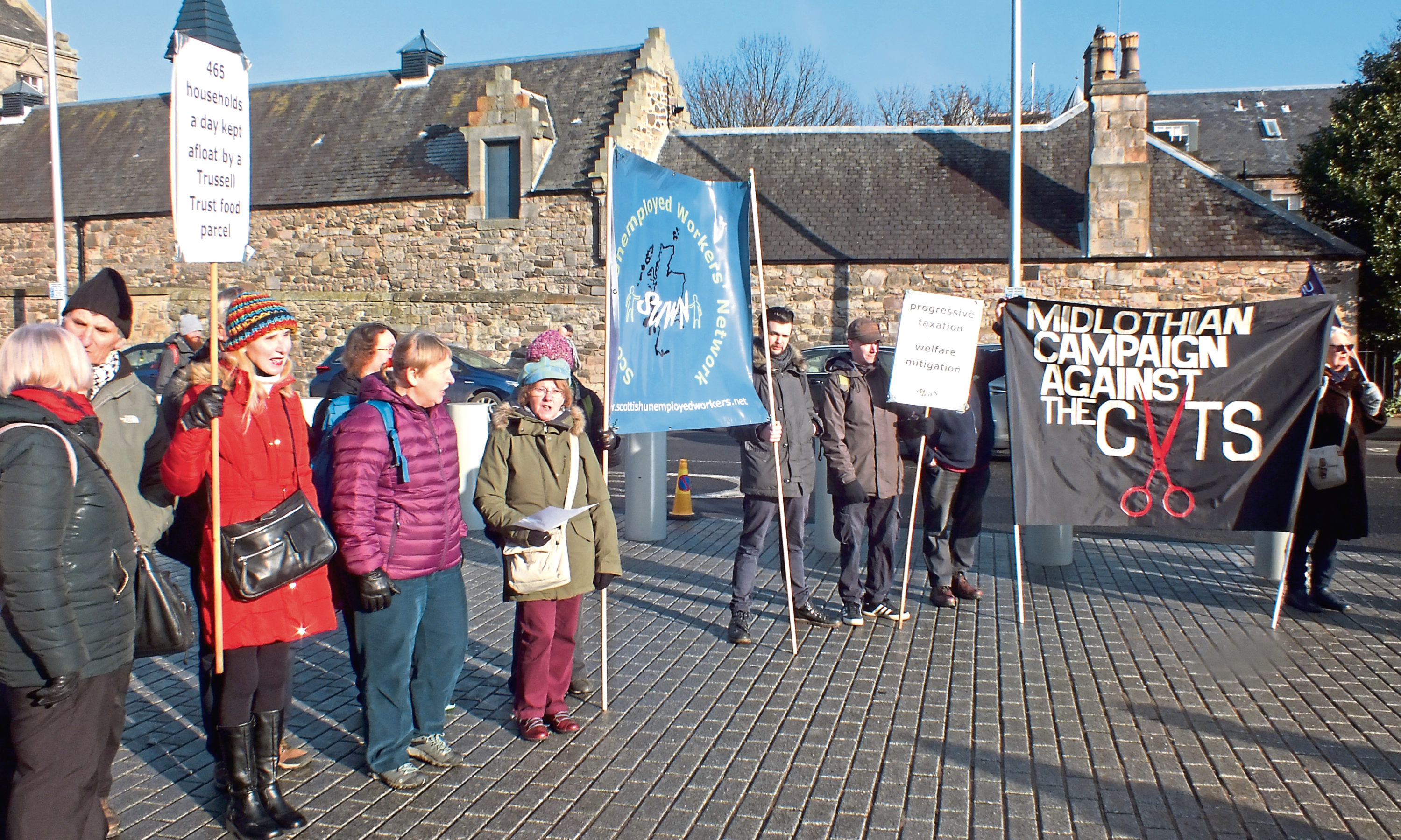 Members of the Scottish Unemployed Workers' Network outside Holyrood