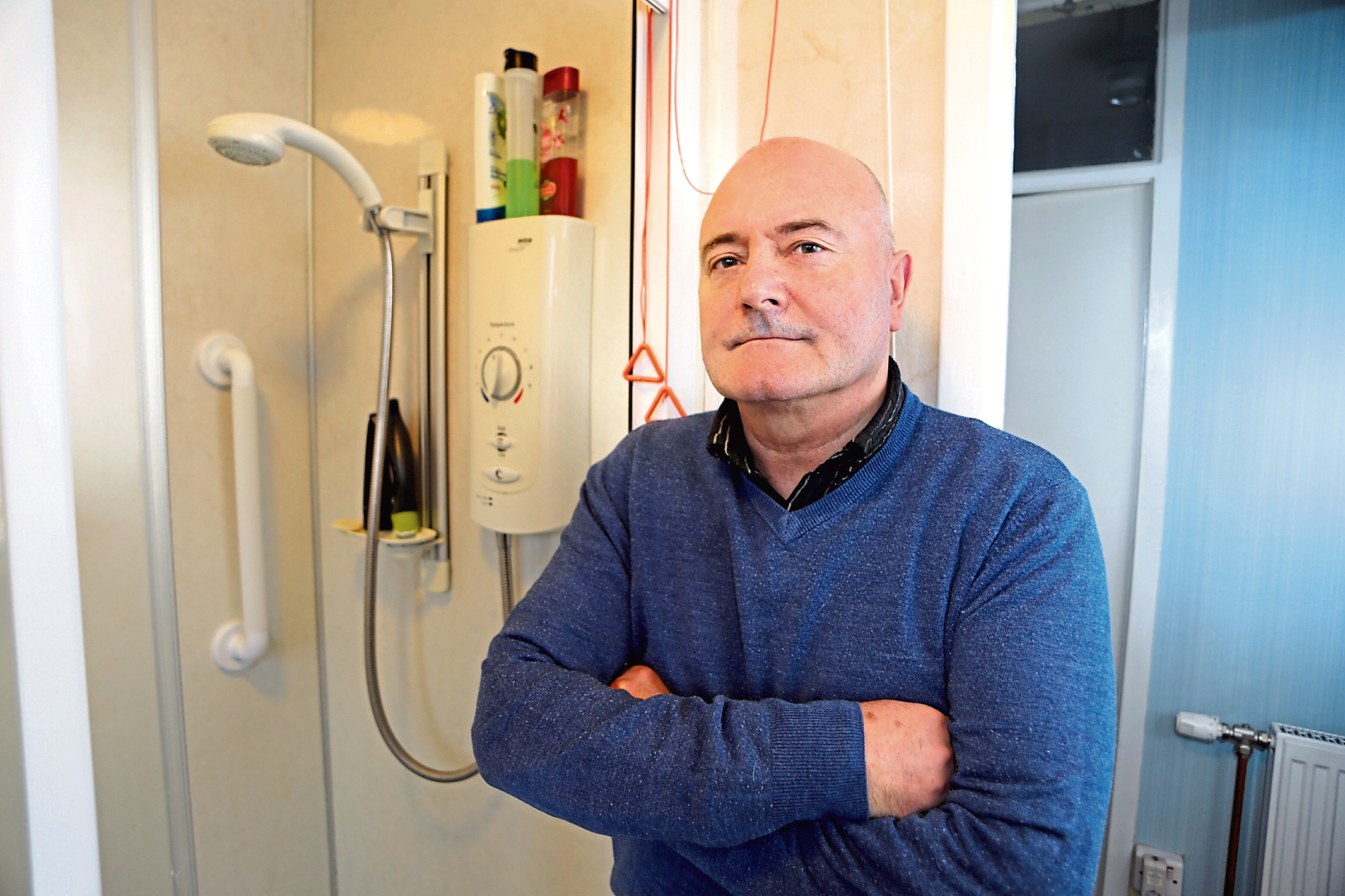 Kenny McPherson is angry at having to pay for a walk-in shower and red cord in his sheltered housing