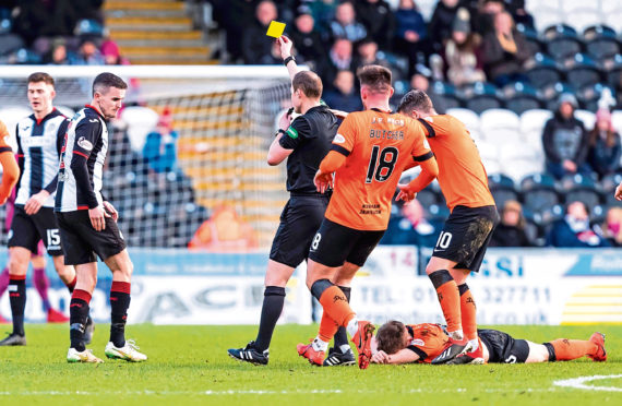 Referee Willie Collum shows a yellow card to Paul McGinn after the St Mirren man had clashed with Dundee United attacker Cammy Smith
