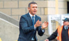 Dundee manager Jim McIntyre encourages his side in his first match in charge