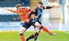 Dundee United's Peter Pawlett (left) battles with St Mirren's Paul McGinn on Saturday
