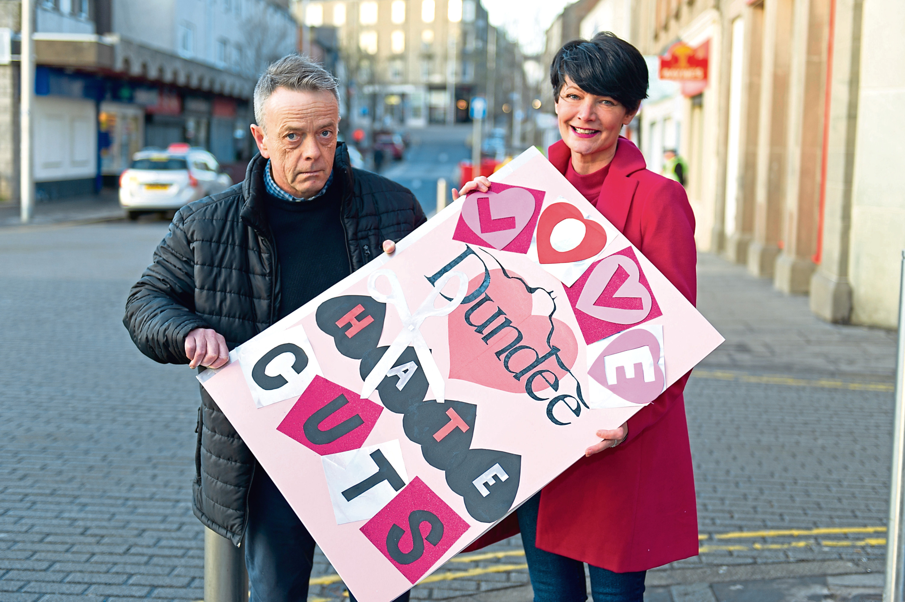 Rory Malone and Jayne Kelly with a Valentine's Card made by campaigners from Lochee that will be presented to John Alexander at the budget