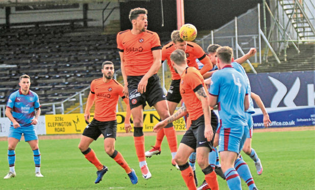 Paul Watson scores Dundee United's opener in the reserve derby against Dundee at Dens Park