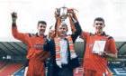 Manager Ivan Golac with the trophy and Craig Brewster (left) and Gordan Petric