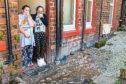 Carol Kilburn and neighbour Gail Taylor at their homes on Dens Road