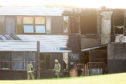 Mhairi Edwards, Evening Telegraph, Jon Brady story, Braeview Academy, Berwick Drive, Dundee, went up in flames last night and we revisited the scene in the morning.  Picture shows; Damage to the school with Fire and police crews still on scene at 8am. Wednesday 12th September, 2018.