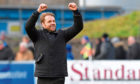 Dundee United manager Robbie Neilson celebrates with the fans at full time on Saturday