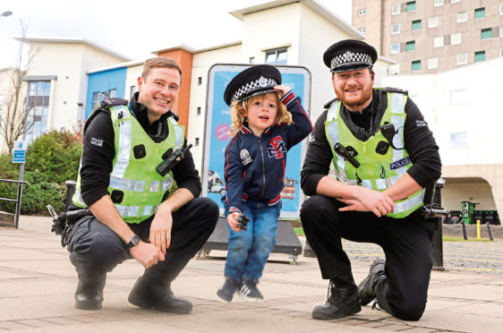 Lochee Community Police constables Lee McConnachie and Liam McLean with Miller McDonald, 3, to promote the event
