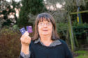 Isobel Macdougall with the now cut up bank card she received in the post