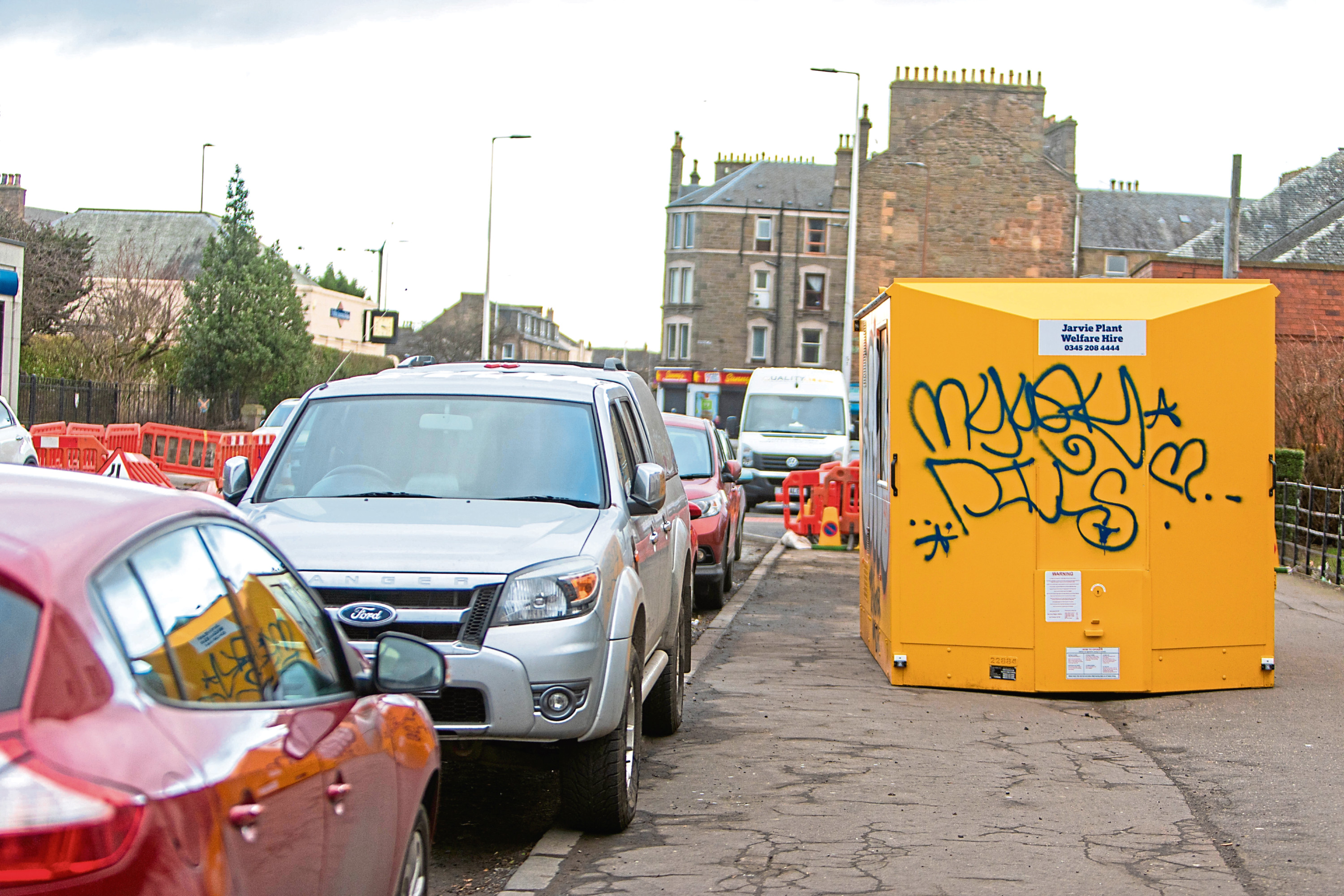 Cars parked on the pavements along with ongoing roadworks have left the area hazardous for pedestrians