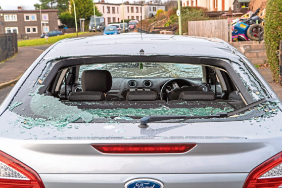 The damaged Ford Mondeo in Dryburgh Crescent