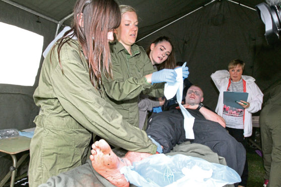 Students taking part in a simulation exercise on Magdalen Green
