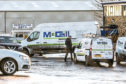 McGill's vans in the yard after it was announced the firm was going into administration