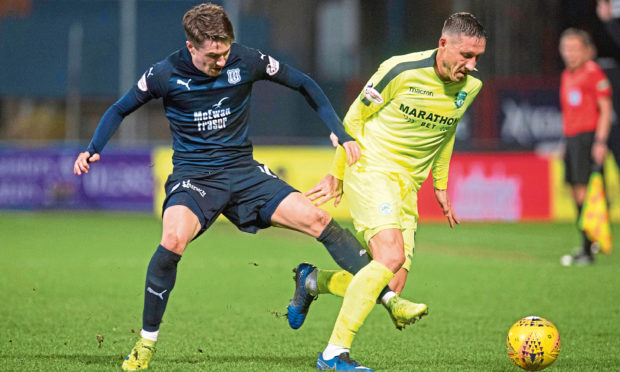 Scott Wright (left) competes with Hibernian's Mark Milligan, during his time with Dundee.