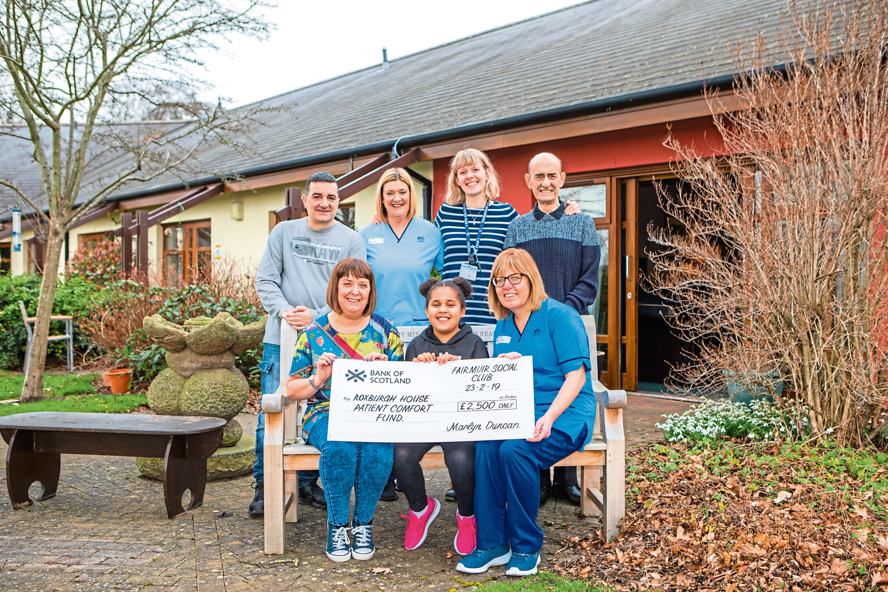 From left, front: Audrey, Indie Ward, 7, and Sarah Bertram (charge nurse); back: David McLaren (Audrey's brother), Pauline Crowe (health care assistant), Dr Kirsty Butt and Christopher McLaren (Audrey's dad)
