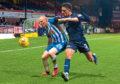 Kilmarnock's Chris Burke (left) holds off Dundee's Nathan Ralph