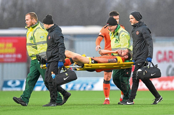 Dundee United's Frederic Frans was stretchered off at Falkirk