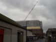 A crane dwarfs above Dundee House as maintenance work takes place on the council building