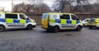 Police vehicles at the Criminal Justice Service building in Friarfield House, Barrack Street, Dundee