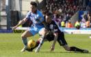 St Mirren's Mateo Muzek (R) battles with Dundee's John O'Sullivan.