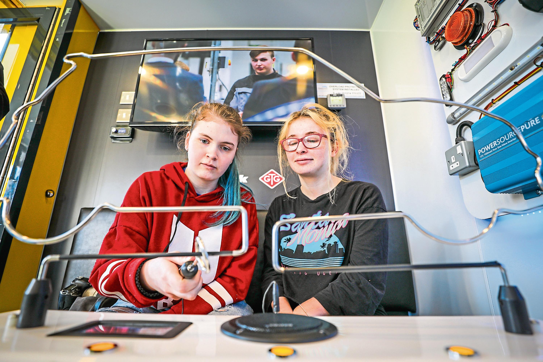 Caitlyn Jones and Steph Jones enjoy one of the exhibits